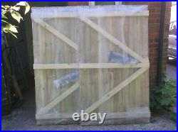 Two feather edge flat topped semi braced strong driveway wooden tiber gates